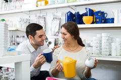 Two customers in the store. Two customers chooses ceramic ware in the store royalty free stock images