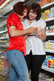 Two customers in supermarket. Stock Photos