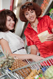 Two customers in supermarket. Stock Image