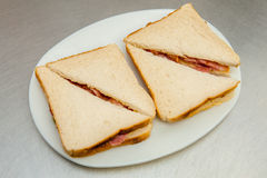 Two cut  bacon sandwiches Stock Photo