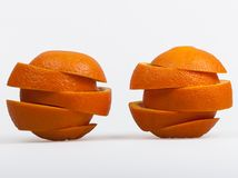Two cut oranges. Photo two cut oranges arranged in layers on the table, shadow-free Royalty Free Stock Image