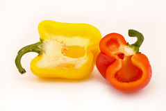 Two cut peppers Royalty Free Stock Photos
