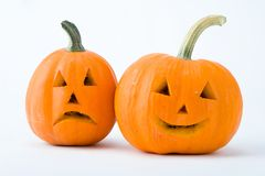 Two cut pumpkins with halloween faces isolated on white background royalty free stock photos