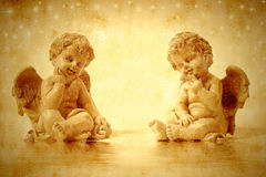 Two cute angels sitting Stock Images
