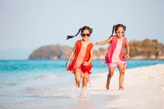 Two asian child girls having fun to play and run on beach together in summer vacation. Two cute asian child girls having fun to play and run on beach together in royalty free stock images