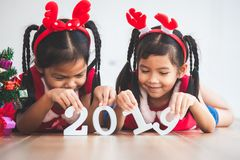 Two cute asian child girls holding numbers 2019 stock images