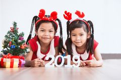Two cute asian child girls holding numbers 2019 royalty free stock image