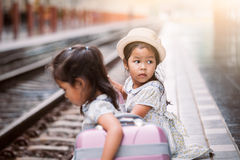 Two cute asian little girls waiting for the train Stock Photography