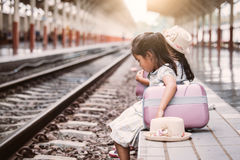 Two cute asian little girls waiting for the train Stock Images