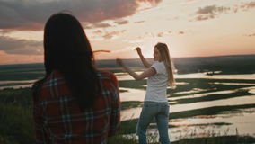 Two Cute attracrive Young girls Taking Photo Nature Landscape Outdoors Countryside Europe stock footage