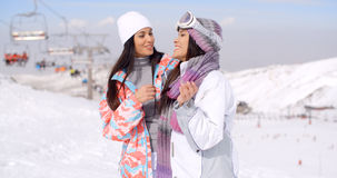 Two cute attractive young women at a ski resort Royalty Free Stock Images