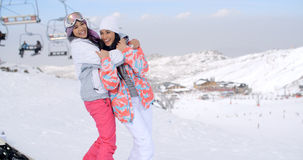 Two cute attractive young women at a ski resort Stock Photography