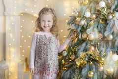 Free Two Cute Awesome Girls Sisters Celebrating New Year Christmas Close To Xmas Tree Full Of Toys In Stylish Dresses With Candies Royalty Free Stock Photo - 105300375