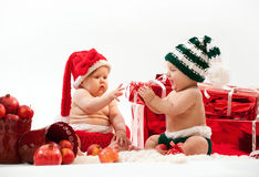 Two Cute Babies In Christmas Costumes Stock Photos