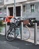 Two cute bikes in the streets of Milano stock image