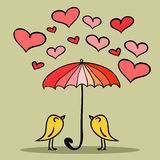 Two cute birds under the umbrella Stock Images