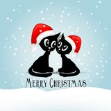 Two cute black cats vith red christmas caps. And text merry christmas, illustration Royalty Free Stock Images