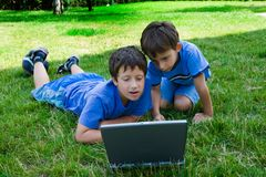 Two cute boy study on computer Royalty Free Stock Photography