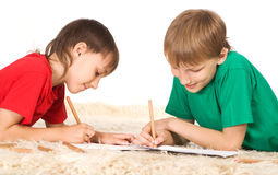 Two cute boys drawing Royalty Free Stock Images