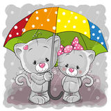 Two cute cartoon kittens with umbrella Royalty Free Stock Images