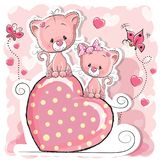 Two Cute Cats. Two cats is sitting on a heart on a pink background Royalty Free Stock Photos