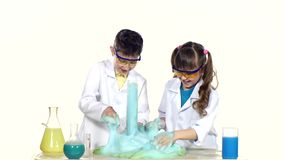Two cute chemist children making interesting and stock video footage