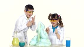 Two cute chemist children making interesting and stock video