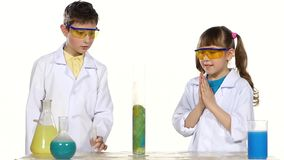 Two cute chemist children making interesting and stock footage