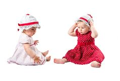 Two cute child girl  isolated on white background. Stock Image
