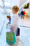 Children with bags in mall Royalty Free Stock Image
