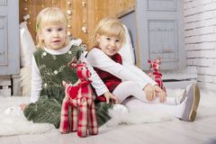 Two cute children at christmas stock photo