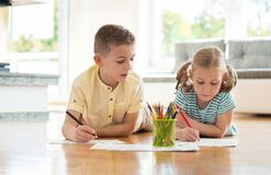 Two cute children draws with colorful pencils at home Royalty Free Stock Photography