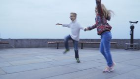 Kids dancing fast dance outdoors stock video footage