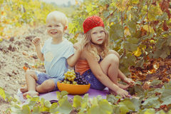 Two cute childrens are having fun outdoor during Stock Photos
