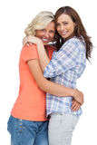 Two cute friends looking at the camera and hugging Stock Image