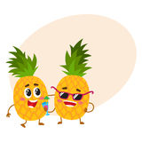 Two cute and funny pineapple characters, one tickling the other Royalty Free Stock Photo