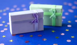 Two boxes with gifts on a blue background. royalty free stock photo