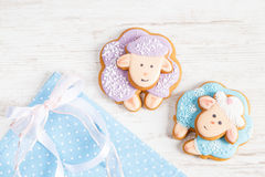 Two cute gingerbread sheep on blue polka dot background Royalty Free Stock Image