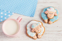 Two cute gingerbread sheep with cup of milk Stock Photos