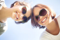 Two cute girl smiling, wearing sunglasses Stock Photo