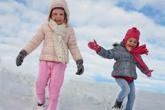 Two cute girl in the snow. stock photography