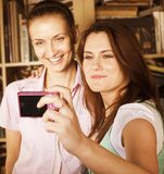 Two cute girlfriends taking photo of themselves Stock Photos