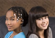 Two cute girls. Two teenage girls friends, one african american the other caucasian Royalty Free Stock Photo