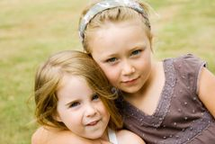 Two Cute Girls. Posing for a photograph outside Royalty Free Stock Photos