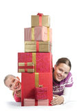 Two cute girls with a bunch of presents Stock Images