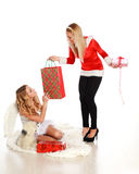 Two cute girls congratulate each other gifts Stock Image
