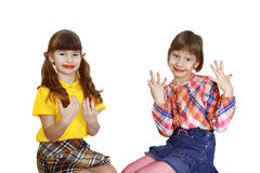 Two cute girls demonstrate painted nails Stock Photo