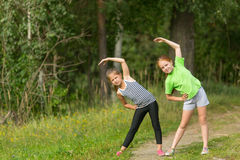 Two cute girls doing exercises workout Royalty Free Stock Image