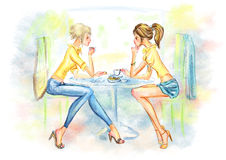 Two cute girls drinking coffee Royalty Free Stock Image