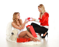 Two cute girls give each other gifts Royalty Free Stock Photo